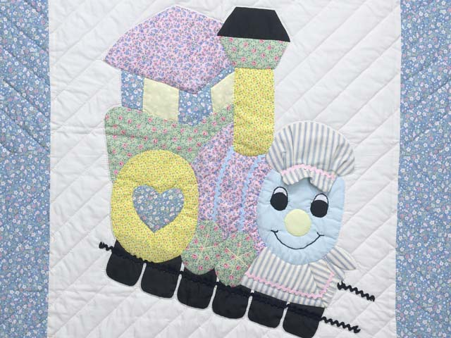 Pastel Blue and Pink Thomas Train Crib Quilt Photo 2