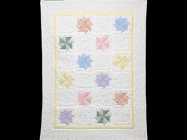 Pastel Yellow and Multicolor Pinwheels Crib Quilt Photo 1
