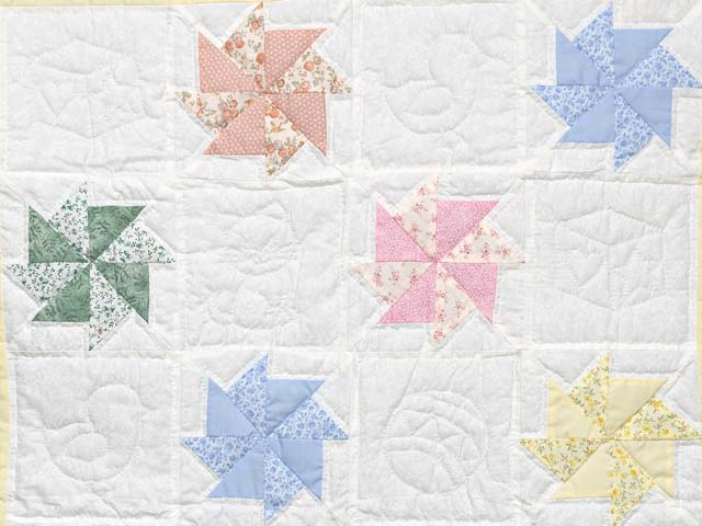 Pastel Yellow and Multicolor Pinwheels Crib Quilt Photo 2