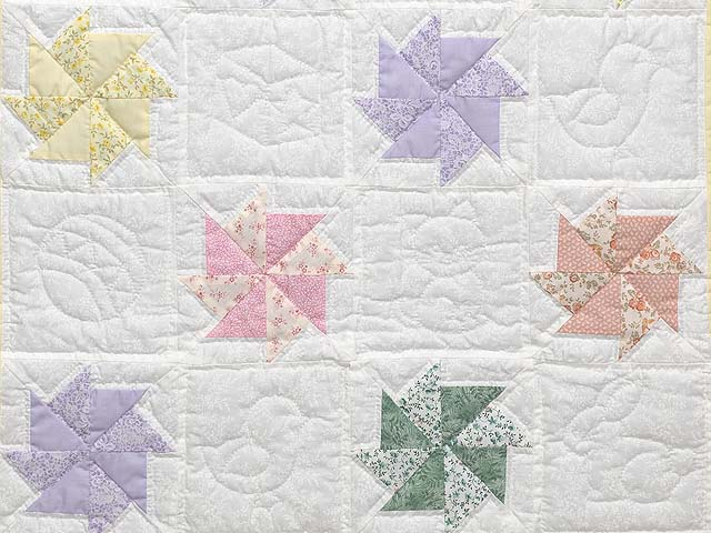 Pastel Yellow and Multicolor Pinwheels Crib Quilt Photo 3