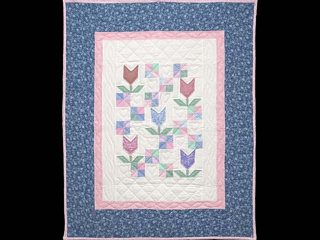 Pastel Patchwork Tulips Crib Quilt Photo 1