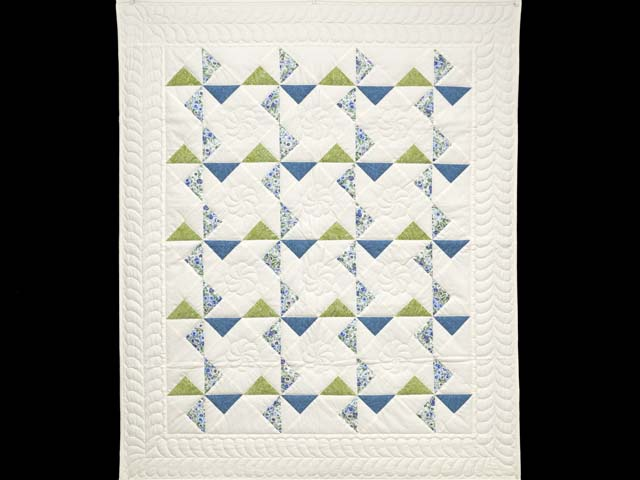Blue Green and Cream Pinwheel Crib Quilt Photo 1