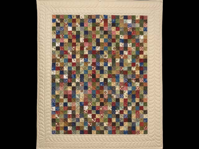 Tan and Multicolor Hit or Miss Crib Quilt Photo 1