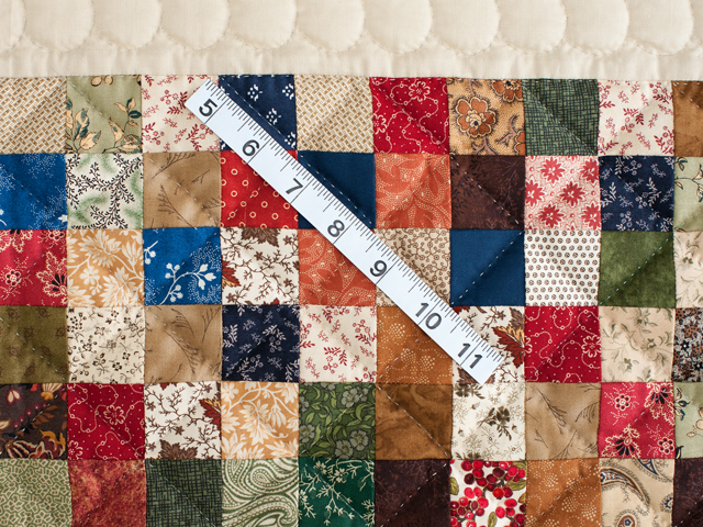 Tan and Multicolor Hit or Miss Crib Quilt Photo 3