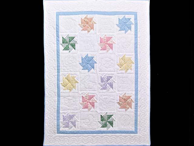 Multicolor Pastel Pinwheels Crib Quilt Photo 1