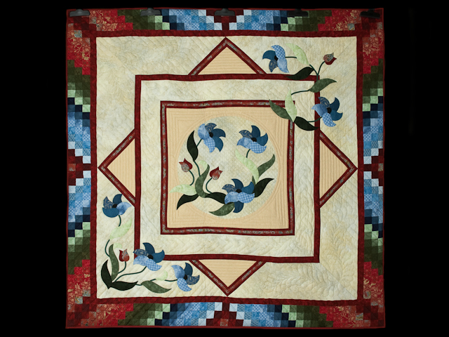 Rainbow Reflections Wall quilt Reds/blues/greens/on ivory Photo 1