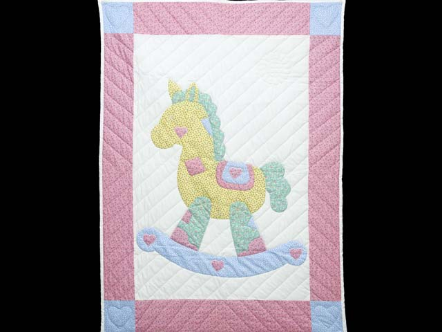 Pastel Pink and Blue Rocking Horse Crib Quilt Photo 1
