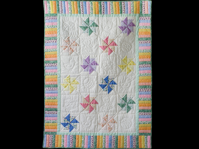 Pastel and Cream Pinwheels Crib Quilt Photo 1