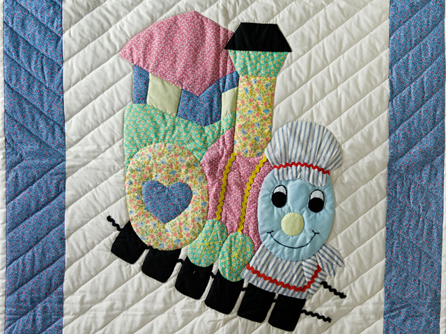 Blue and Pastel Thomas Train Crib Quilt Photo 2