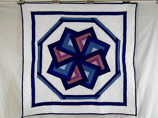 Blue and Mauve Spinning Star Wall Hanging Photo 1