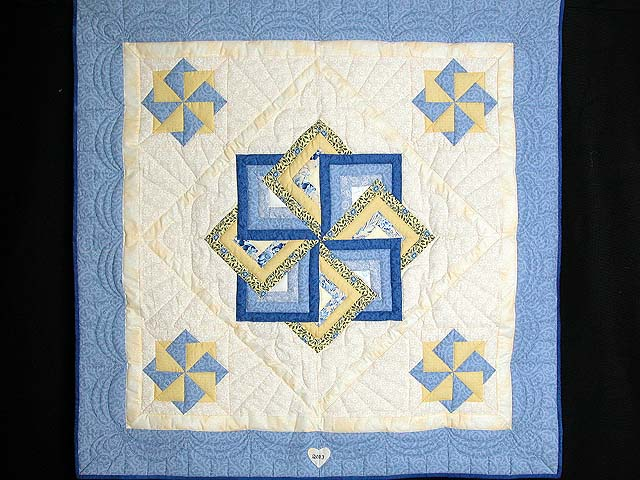 Blue and Yellow Star Spin Wall Hanging Photo 1