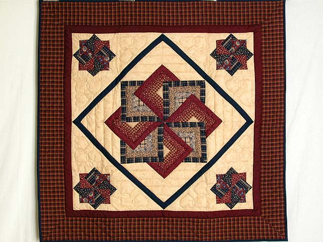 Burgundy Navy and Tan Star Spin Wall Hanging Photo 1