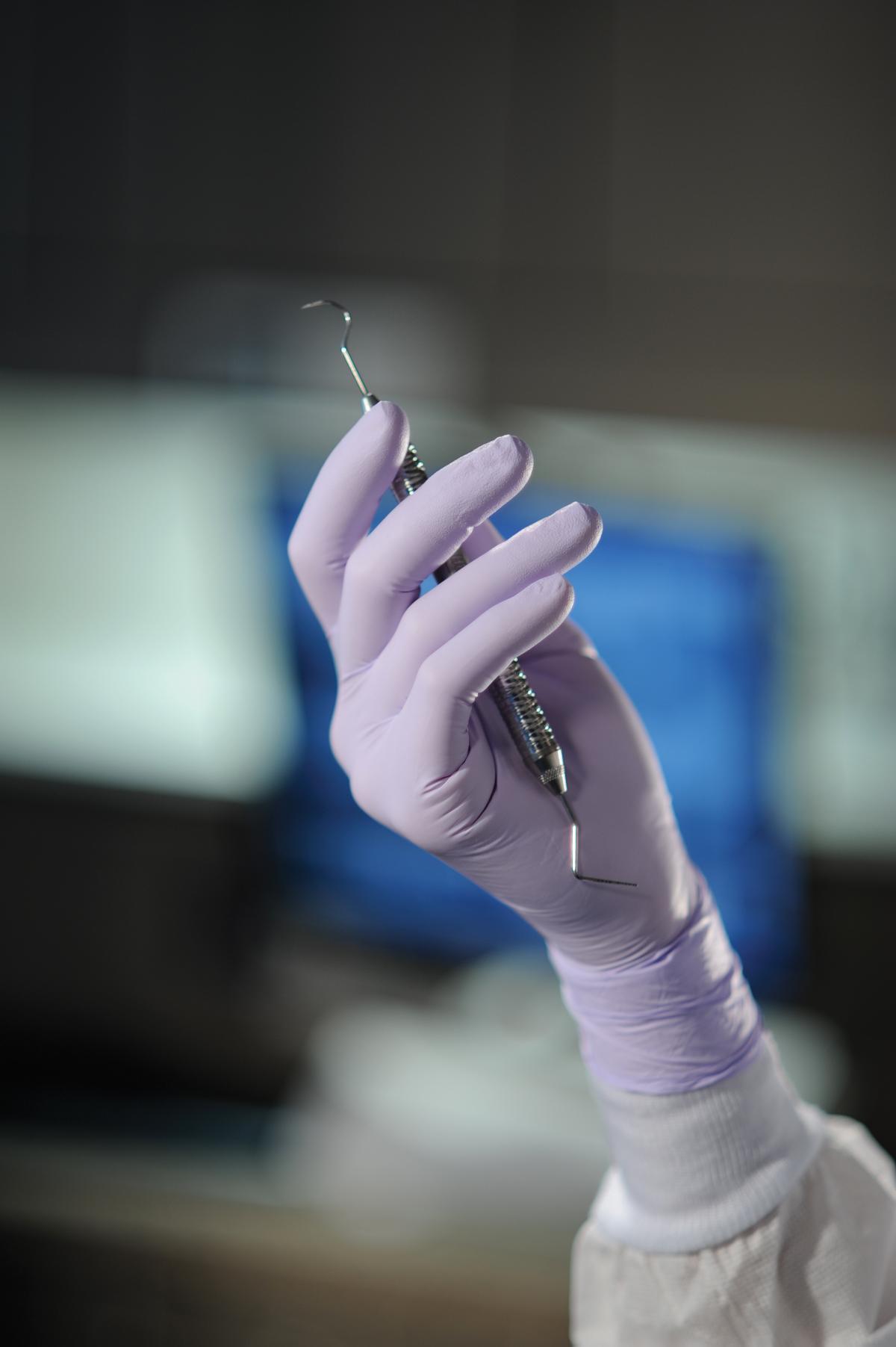 Textured latex exam gloves