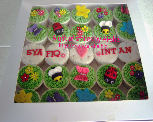 cupcake with lady bug and bumble bee in a box