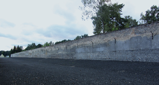 A wall in Ravensbrück; the dynamic sky (symbol of freedom for the prisoners) above it.