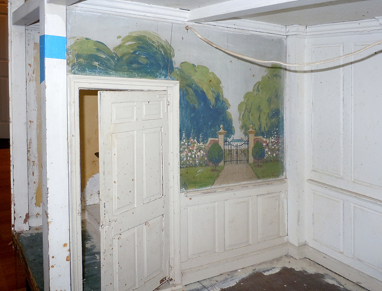 One of the two murals and the fine woodwork.