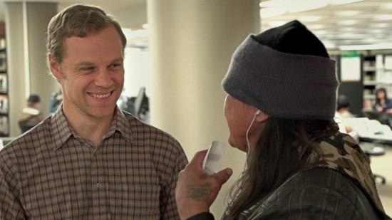 Jared Tkachuk talks to a homeless EPL patron