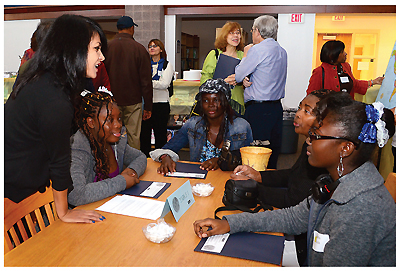 MIX & MINGLE Volunteers and newcomer immigrants at a Welcoming gathering hosted by Connecticut's Hartford Public Library. Photo by Homa Naficy, Hartford PL