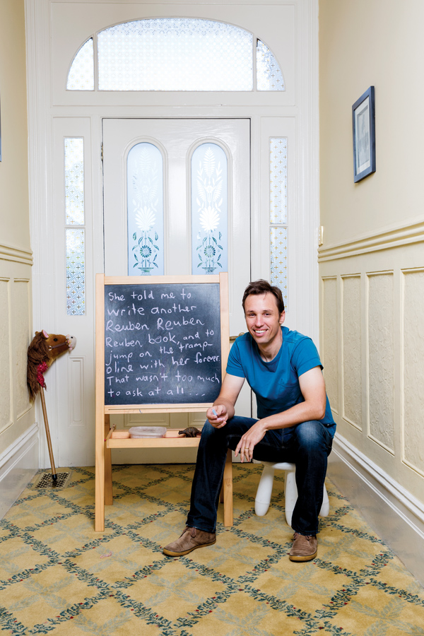 The photographer asked Zusak to write a sentence on his daughter's chalkboard. He wrote something he remembered her saying. All photos by James Horan.