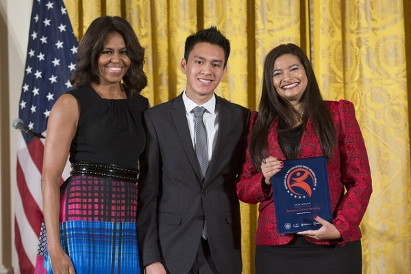 TeenSpace Circle for Mentoring representatives Josue Rodriguez Espinoza (center) and Cheryl Eberly (right) accept the 2014 National Arts and Humanities Youth Program Award from First Lady Michelle Obama. Photo credit: Steven E. Purcell