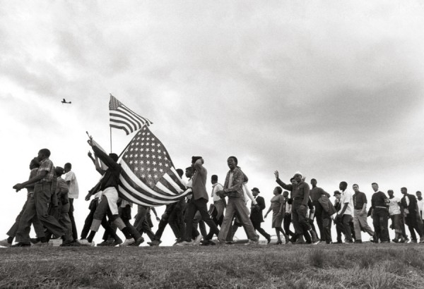 Freedom Marchers with Flags, 1965. Photo by Matt Heron