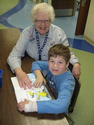 Bev Casperson and first grader Isaac Briggs.
