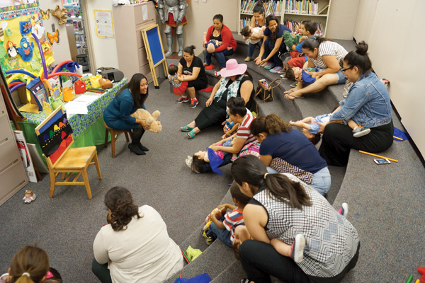 Silvia Cisneros leads bilingual storytime for babies at the Santa Ana (CA) Public Library. Photo by David Lopez/Courtesy of Santa Ana Public Library