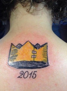 Victoria Stapleton's Beekle crown and Caldecott-winning year tattoo.