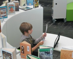 Student in the library at Barrows Elementary School.