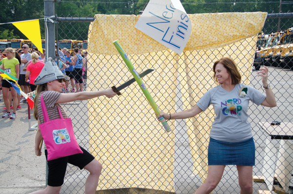 Author Jess Keating and fourth grade teacher (and Nerdcamp organizer) Suzanne Gibbs dueling during Nerd Run.