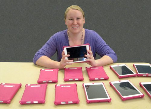Carrie Rogers-Whitehead with the 12 grant-awarded iPad Minis used in Sensory Schoolage Fun.
