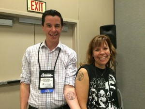 "LJ Movers & Shakers and Dr. Who fans Matthew Winner and Sherry Gick show of their freshly inked tattoos, which say ""Mover and Shaker"" in Gallifreyean."
