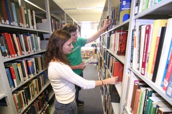 Students from Rivendell School (Orford, NH) find their own books from the stacks (photo credit, Bruce Lyndes)