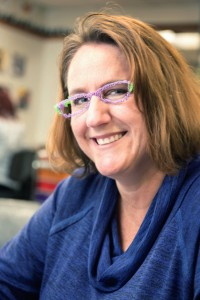 Karen Jensen dons glasses created with a 3-D printer pen.