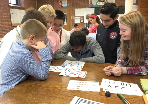 Worcester students work with Ozobot.