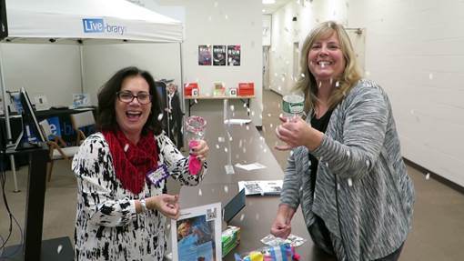 Seymour, left, and Cindy Norman, South Street School in Eastport-South Manor (NY) school district try their hand at confetti poppers. Photo courtesy of Fran Knoedl.