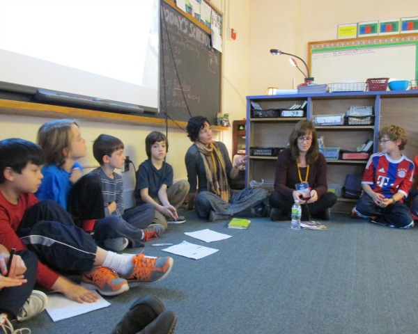 Baskin (center, with scarf) speaks to Mt. Kisco fourth-graders. Polos is to her right.