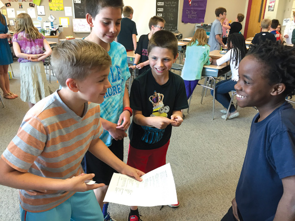 "Fifth graders practice their rap battle skills with the lyrics from ""Right Hand Man."""