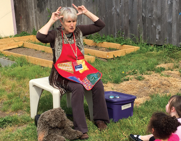 Librarian Susan Anderson-Newham leads a storytime at a acoma, WA, child-care center.