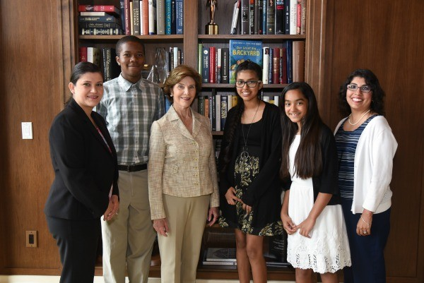 """Mrs. Bush with students from the Dallas Environmental Science Academy, as well as librarian, Tabatha Sustaita-Robb and principal Diana Nunez, during the """"Our Great Big Backyard"""" book event at the George W. Bush Presidential Center. Photo by Grant Miller"""