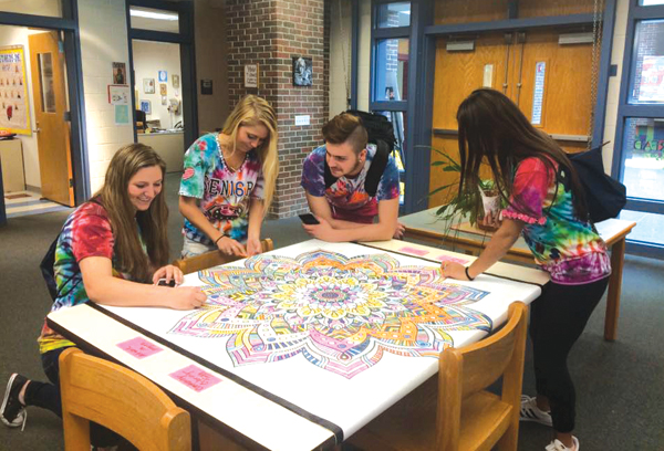 An oversized coloring sheet at Cellucci's library offered students a chance to relax during finals in May and June. Photo courtesy of Westborough High School library