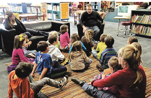 Burleson reads a picture book to first graders. Courtesy of Todd Burleson/ Hubbard Woods School