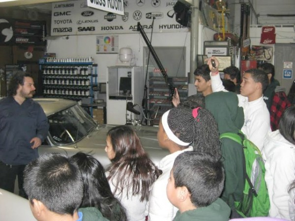 Holzweiss's class enjoys a demo from an expert at the Autoseum on Long Island.
