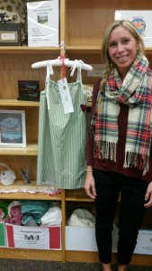 Sewing teacher Heidi Stevens with one of the Little Dresses for Africa her students made through the MakerCare Program.