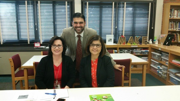 Gina Seymour, left, with principal Michael Mosca and ELL coordinator Claudia Osorio