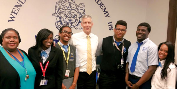 Boyd (above left) with WPAHS students and former U.S. Secretary of Education Arne Duncan (center), who toured the school and the library in 2015.