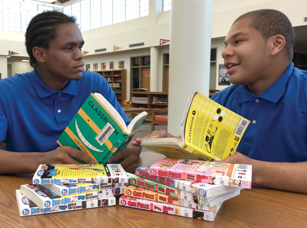 Two of Boyd's students at the WPAHS library