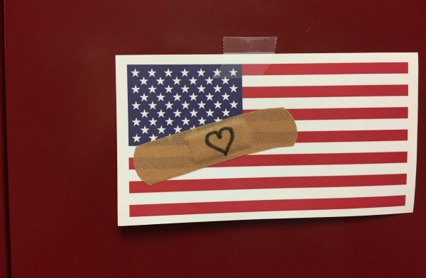 Student artwork at Silver Creek High School, Longmont, CO. Students created flags with Band-Aids and taped a postcard size image of it on every locker in building, says librarian Phil Goerner.