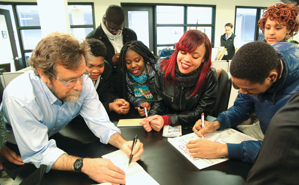 Through a News Literacy Project initiative, students at Washington, DC's Thurgood Marshall Academy Public Charter School visit the Politico newsroom and get a cartooning lesson from political cartoonist Matt Wuerker. Photo by Maureen Freeman