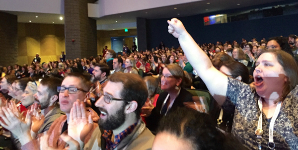 ALAYMA-crowd-fist-raised